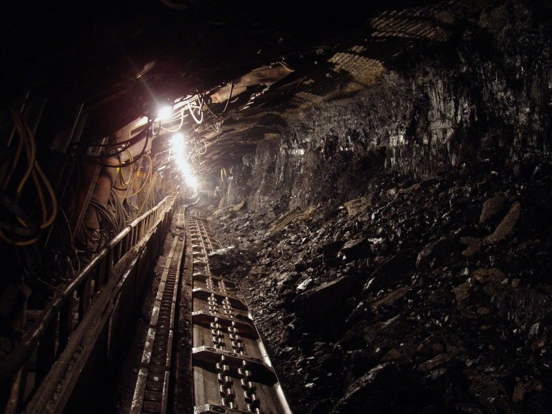 A dark coal mine. Links to an OSHA page detailing complying with the Silica standard.
