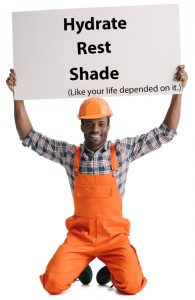 A construction worker wearing a hard hat while holding up a sign telling people to hydrate, take plenty of rest breaks, and seek shade to prevent heat exhaustion on the worksite.