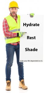Construction worker holding a sign telling people to hydrate, get rest, and get in the shade to avoid heat exhaustion.