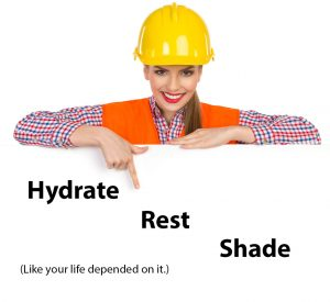A female construction worker smiling and holding a sign informing people to hydrate, get work breaks in, and seek shade to help prevent getting a heat stroke.